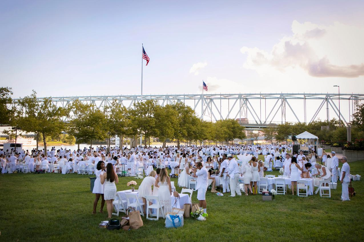 "Diner en Blanc, the annual ""chic picnic,"" was held at Yeatman's Cove on Saturday, September 15. The exclusive club revealed the location of the dinner only at the last minute to attendees. Dressed in all white clothing, everyone celebrated the beauty of the city with people from diverse backgrounds over a shared meal. Diner en Blanc began 30 years ago in Paris, France, and eventually made its way stateside in the last decade. 120,000 guests attend dinners across the world on an annual basis. / Image: Mike Bresnen // Published: 9.16.18"