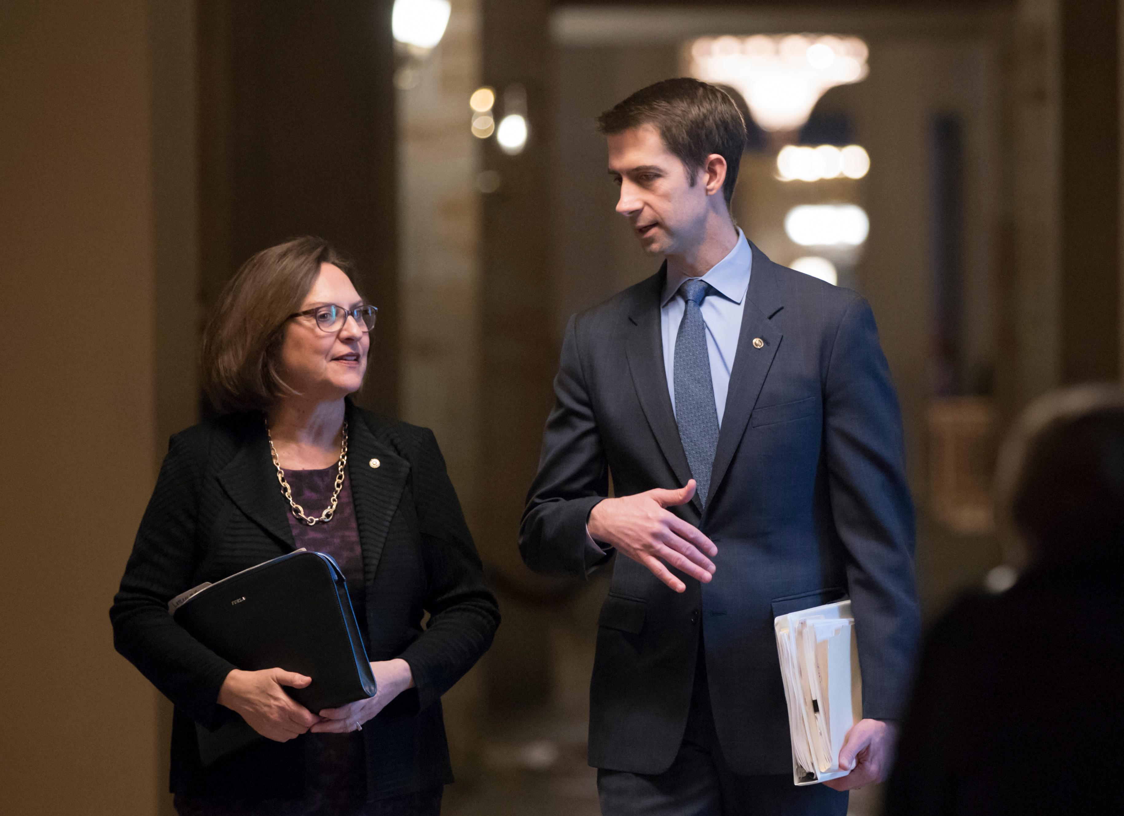 Sen. Deb Fischer, R-Neb., left, and Sen. Tom Cotton, R-Ark., leave the office of Senate Majority Leader Mitch McConnell, R-Ky., just before the announcement of an agreement in the Senate on a two-year, almost $400 billion budget deal that would provide Pentagon and domestic programs with huge spending increases, at the Capitol in Washington, Wednesday, Feb. 7, 2018. (AP Photo/J. Scott Applewhite)