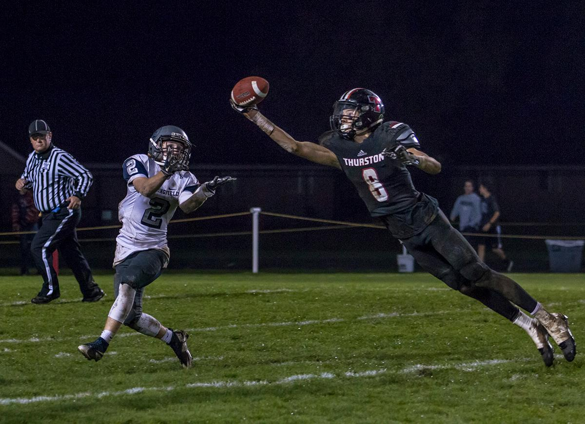 Thurston Colts Ethan Powell (#8) attempts to intercept a pass intended for Springfield Millers Jake Parson (#2). Thurston defeats Springfield 39-36 in the last game of the regular season. Photo by Whitney Bradshaw, Oregon News Lab