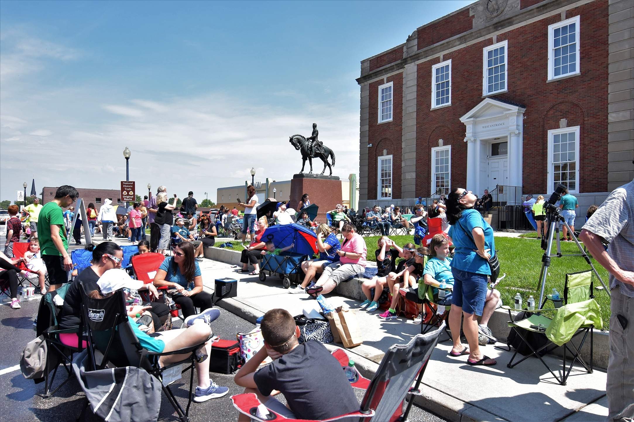 Crowds begin to form at Independence Square as the skies clear prior to the start of the eclipse. [David M. Rainey/Special to The Examiner]