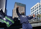323aca08-a544-4e69-8e11-7fde32494046-140205_a3_sea_parade_Seahawks_Parade_Football_1.jpg