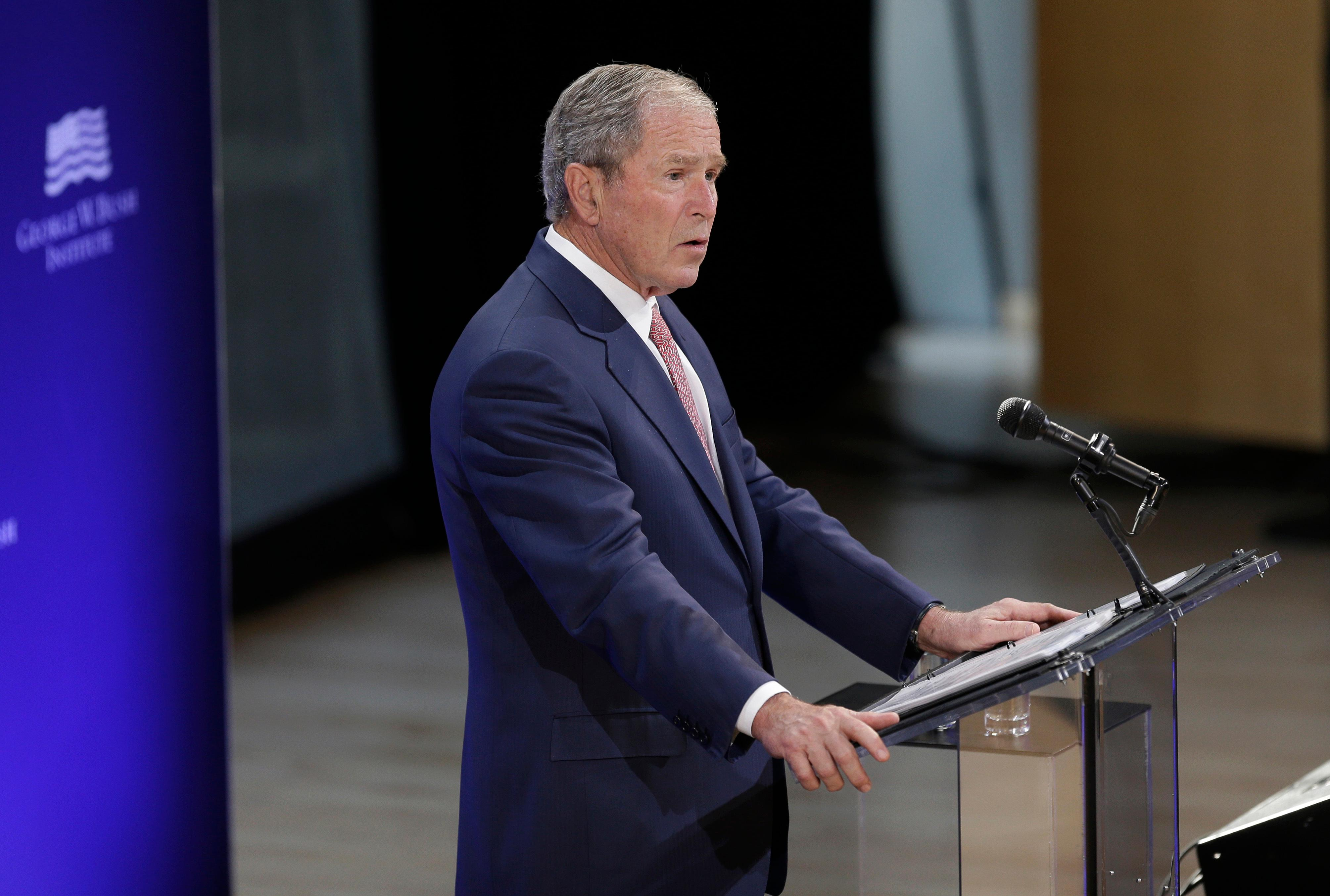 Former U.S. President George W. Bush speaks at a forum sponsored by the George W. Bush Institute in New York, Thursday, Oct. 19, 2017. (AP Photo/Seth Wenig)