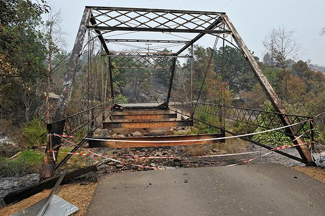 Jamie Lusch / Mail Tribune<br>The Klamathon fire burned a bridge off of Cottonwood Creek Road near the town of Hornbrook.