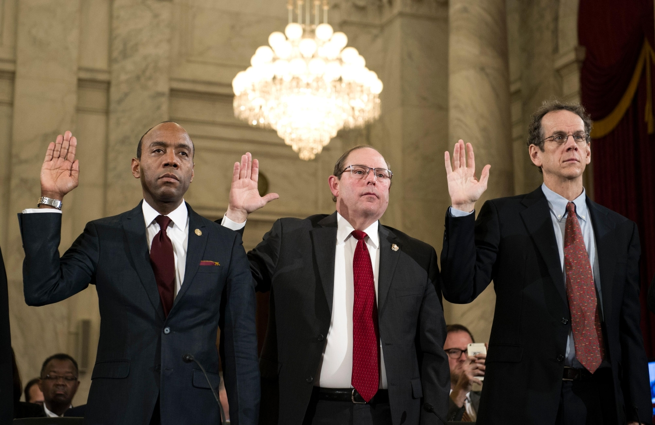 From left, NAACP President Cornell Brooks, Fraternal Order Of Police National President Chuck Canterbury, and ACLU Legal Director David Cole are sworn in on Capitol Hill in Washington, Wednesday, Jan. 11, 2017, prior to testifying at Attorney General-designate, Sen. Jeff Sessions, R-Ala. confirmation hearing before the Senate Judiciary Committee.  (AP Photo/Cliff Owen)