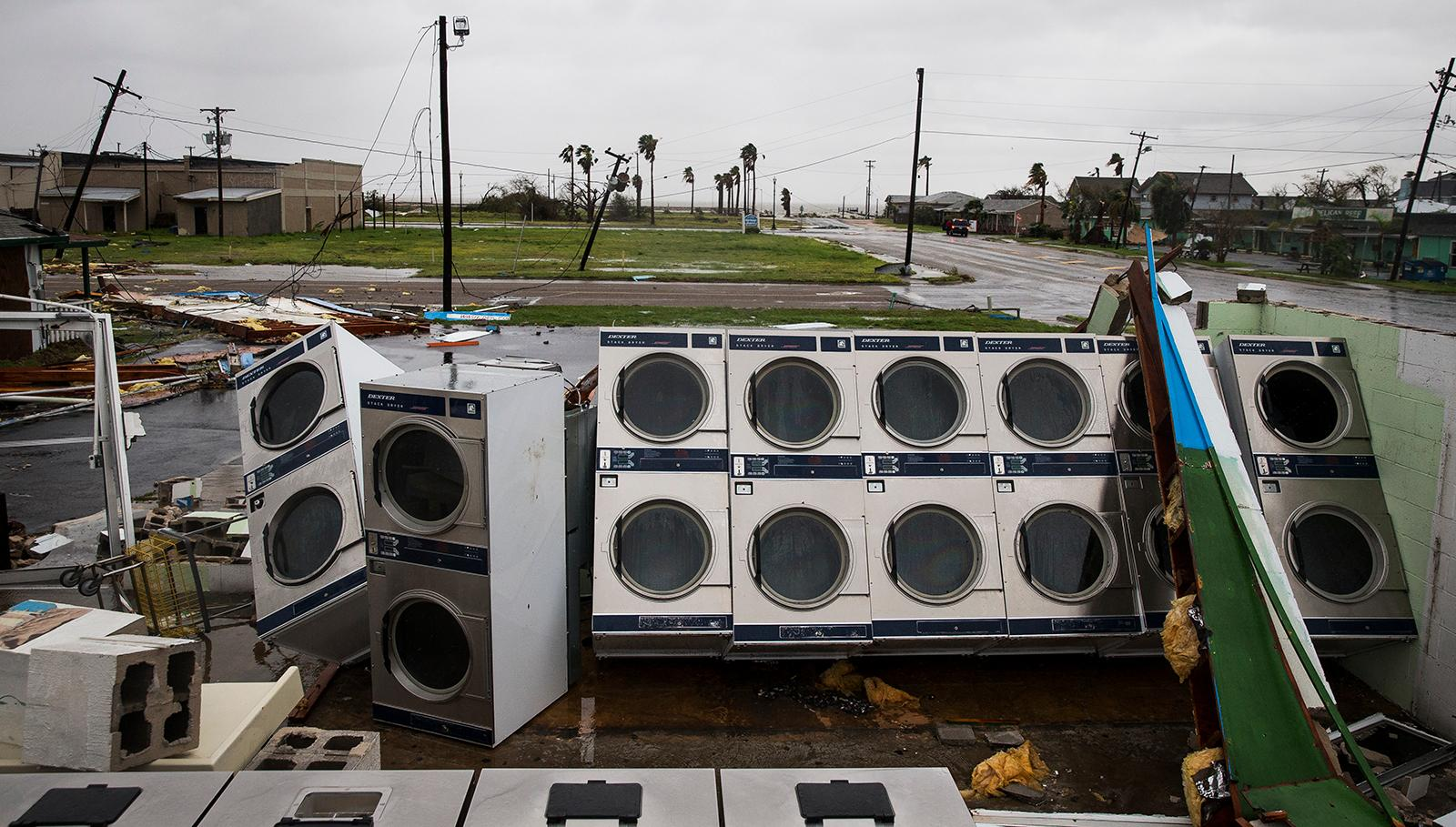 A laundromat's machines sit exposed in the elements after Hurricane Harvey ripped through Rockport, Texas, on Saturday, Aug. 26, 2017.  The fiercest hurricane to hit the U.S. in more than a decade spun across hundreds of miles of coastline where communities had prepared for life-threatening storm surges — walls of water rushing inland.  (Nick Wagner/Austin American-Statesman via AP)