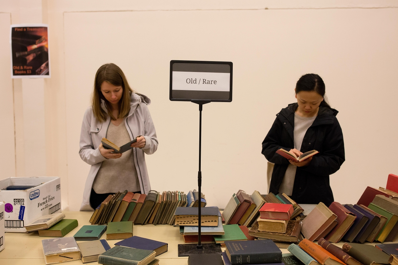 Book enthusiasts sort through old and rare books at the Big Book Sale 2017.