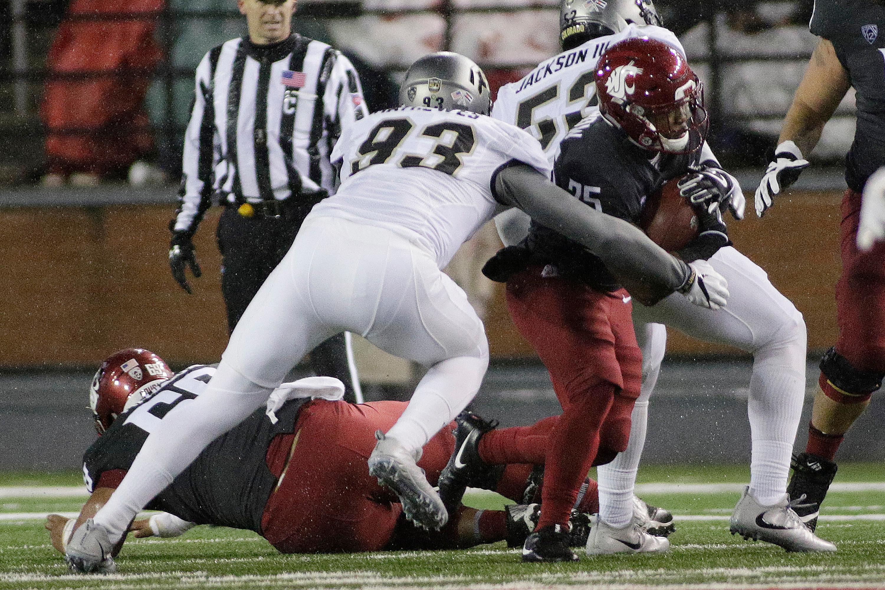 Colorado linebacker Michael Mathewes (93) tackles Washington State running back Jamal Morrow (25) during the first half of an NCAA college football game in Pullman, Wash., Saturday, Oct. 21, 2017. (AP Photo/Young Kwak)