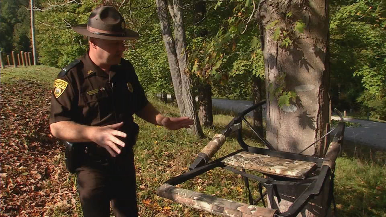 Lieutenant Ed Goodson, a WV Natural Resources police officer, demonstrates the correct way to attach a tree stand. (WCHS/WVAH)