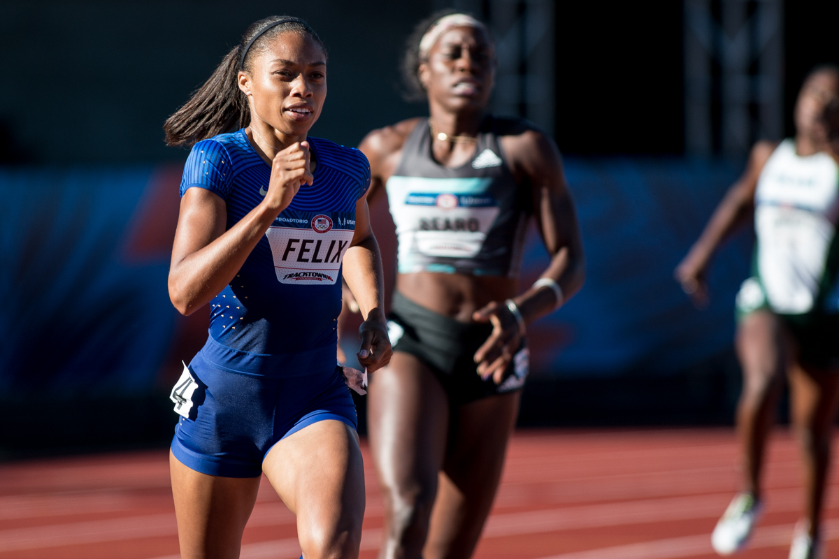 Nike�s Allyson Felix sprints around the Bowerman curve en route to running a 51.96 in the women�s 400m. She will advance to the next round. Photo by Dillon Vibes
