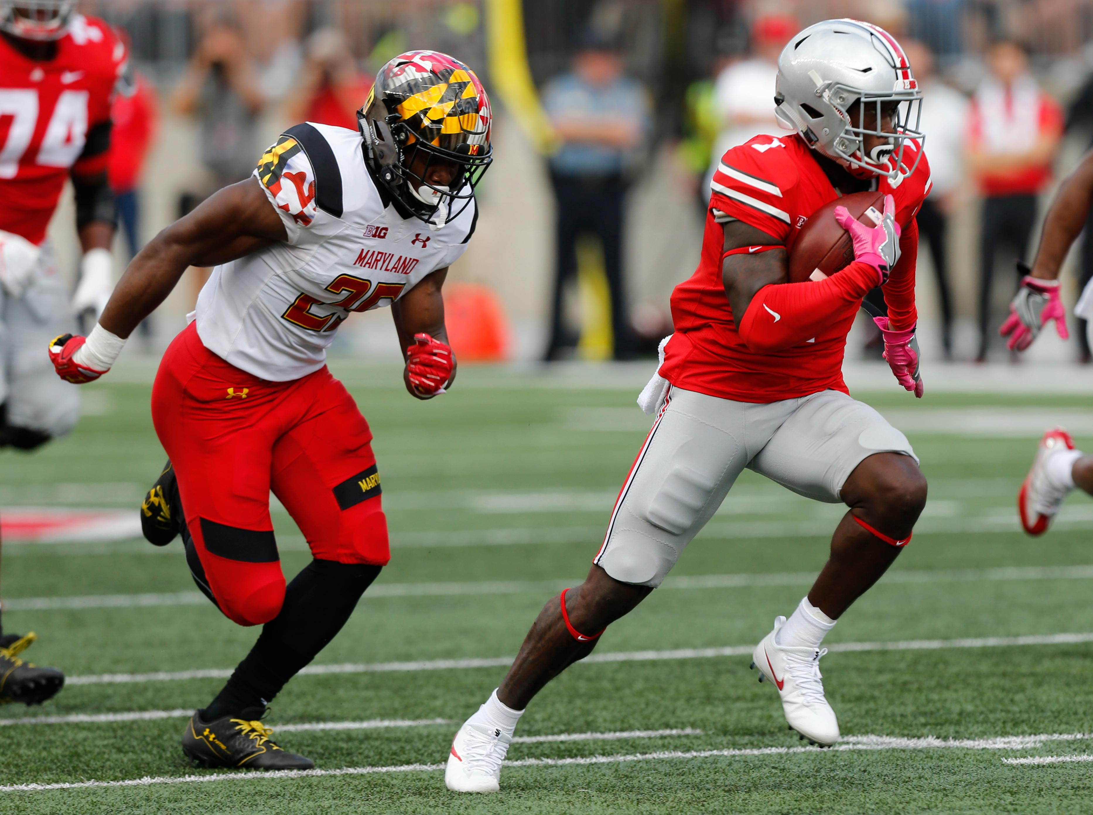 Ohio State receiver Johnnie Dixon, right, runs after a catch as Maryland defender Antoine Brooks chases him during the first half of an NCAA college football game Saturday, Oct. 7, 2017, in Columbus, Ohio. (AP Photo/Jay LaPrete)
