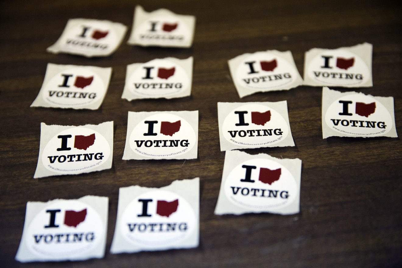 Stickers are set on a table for voters who have cast their ballots in the primary election Tuesday, March 15, 2016, in Chesterville, Ohio. (AP Photo/Matt Rourke)