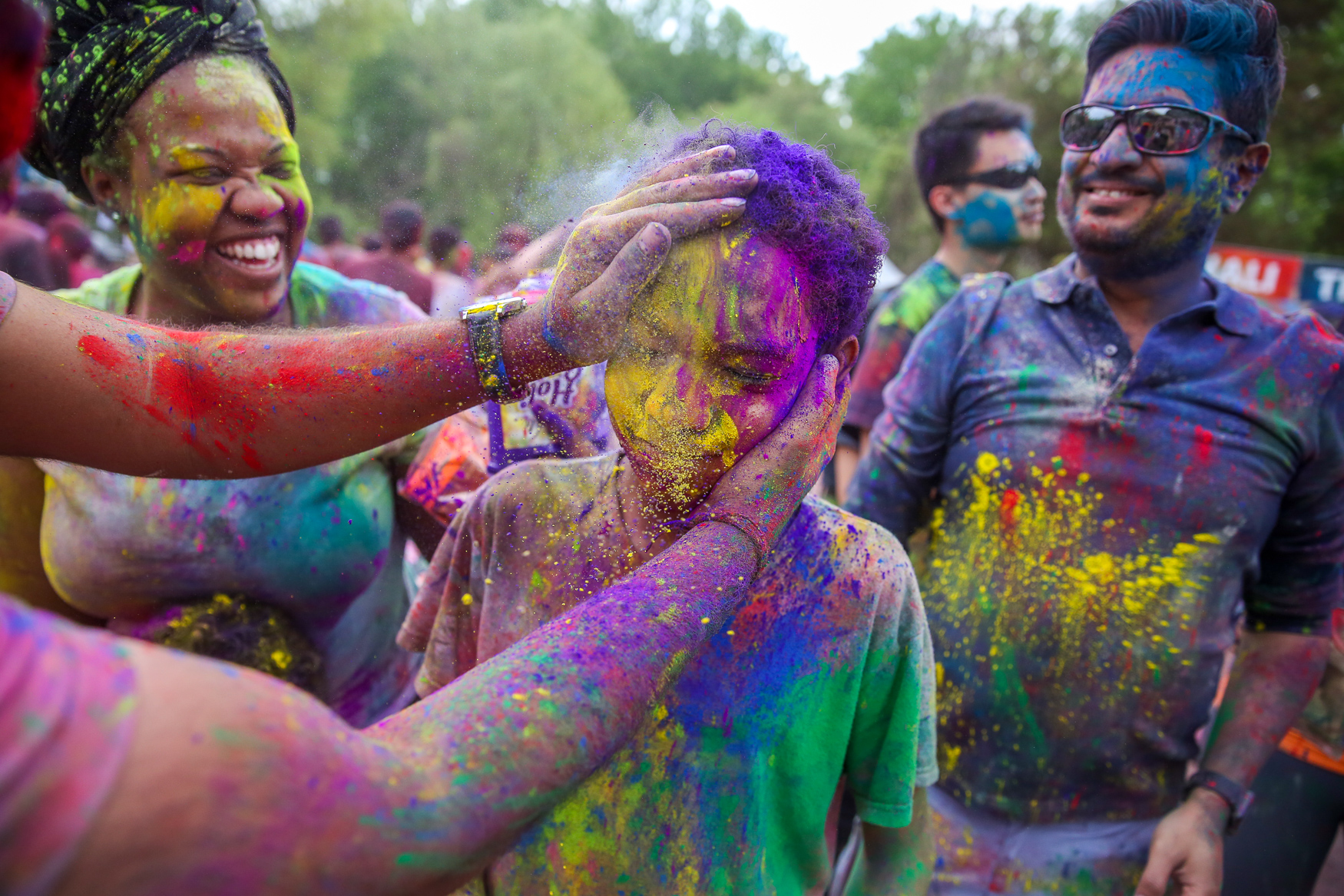 Revelers coat a child in colored powder at Holi, a Hindu festival at ISCKON of D.C. on March 6, 2018.{ }(Amanda Andrade-Rhoades/DC Refined)