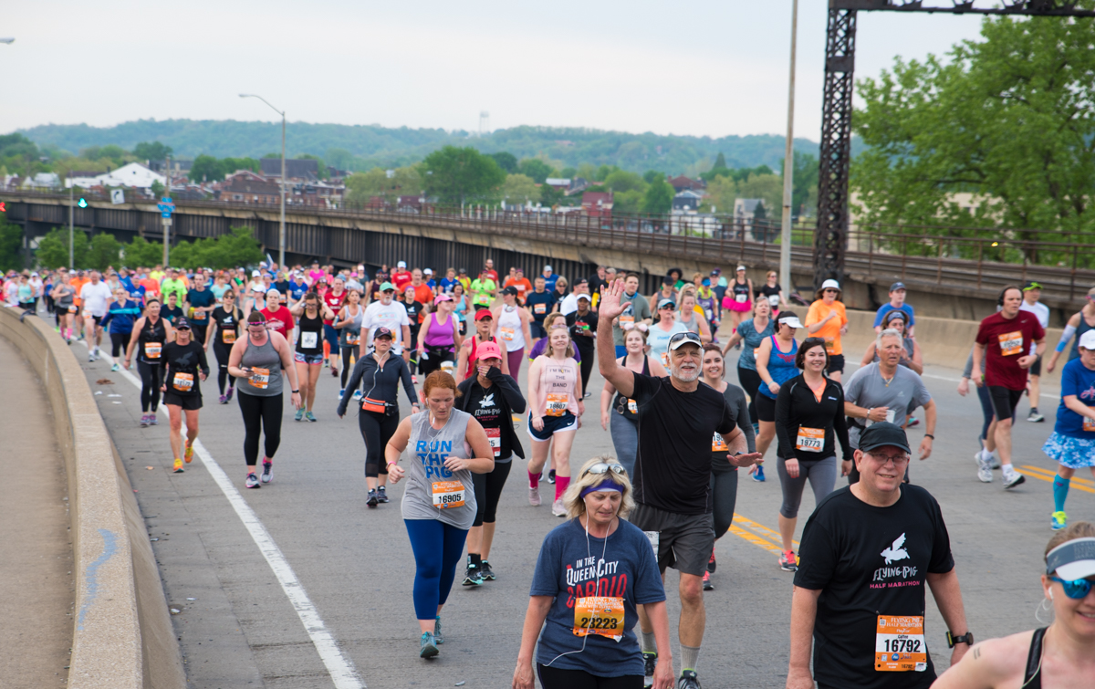 "The 20th Flying Pig full and half marathons were held on Sunday, May 6. Runners began at Paul Brown Stadium and snaked their way through NKY and Cincinnati before finally ending at the ""Finish Swine"" located on Mehring Way on the opposite side of the stadium. / Image: Sherry Lachelle Photography // Published: 5.7.17<p></p>"