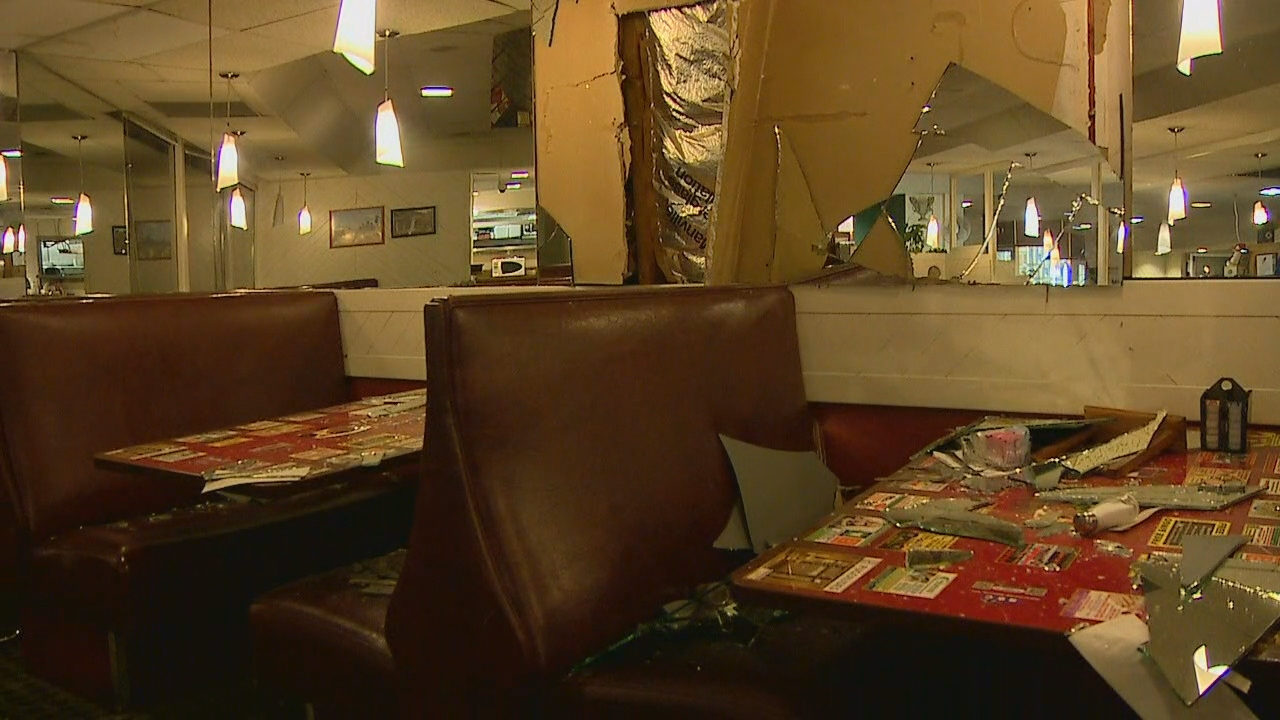 Two people are hospitalized with life-threatening injuries after their car crashed into a restaurant in Renton Tuesday night. (Photo: KOMO News)