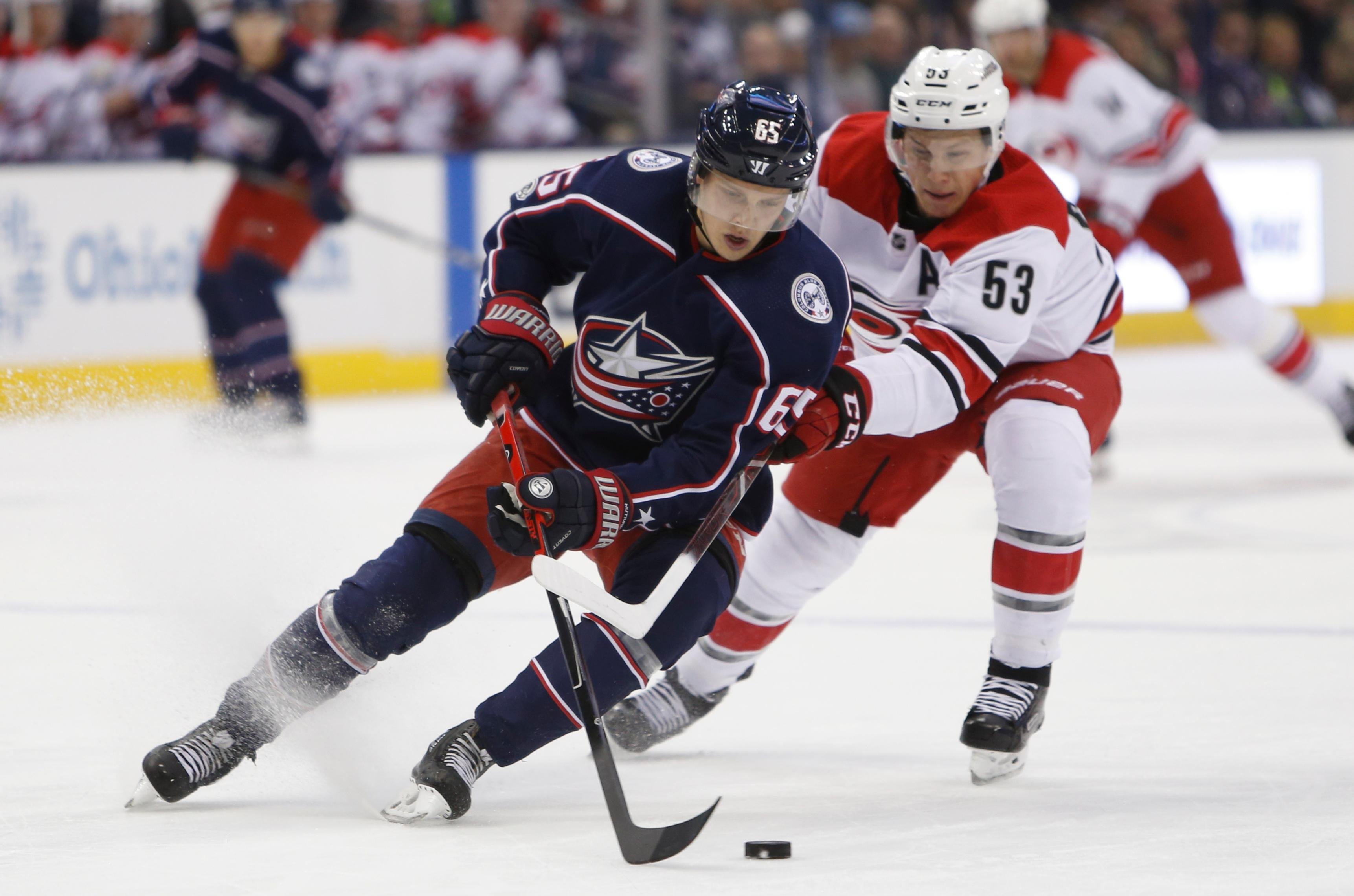 Columbus Blue Jackets' Markus Nutivaara, left, of Finland, tries to clear the puck past Carolina Hurricanes' Jeff Skinner during the first period of an NHL hockey game Friday, Nov. 10, 2017, in Columbus, Ohio. (AP Photo/Jay LaPrete)