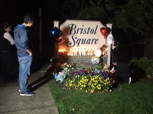 A memorial grows outside the Bristol Square Apartments in Lynnwood where the body of 6-year-old Dayvid Pakko was found early Tuesday. (Photo: KOMO News)<p></p>