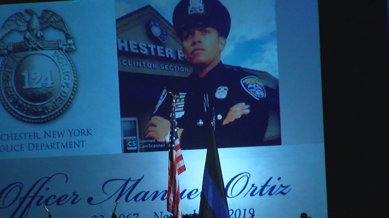 The slideshow is set to begin playing inside the memorial service for Rochester Police Officer Manuel 'Manny' Ortiz on Friday, November 8, 2019. (WHAM photo)