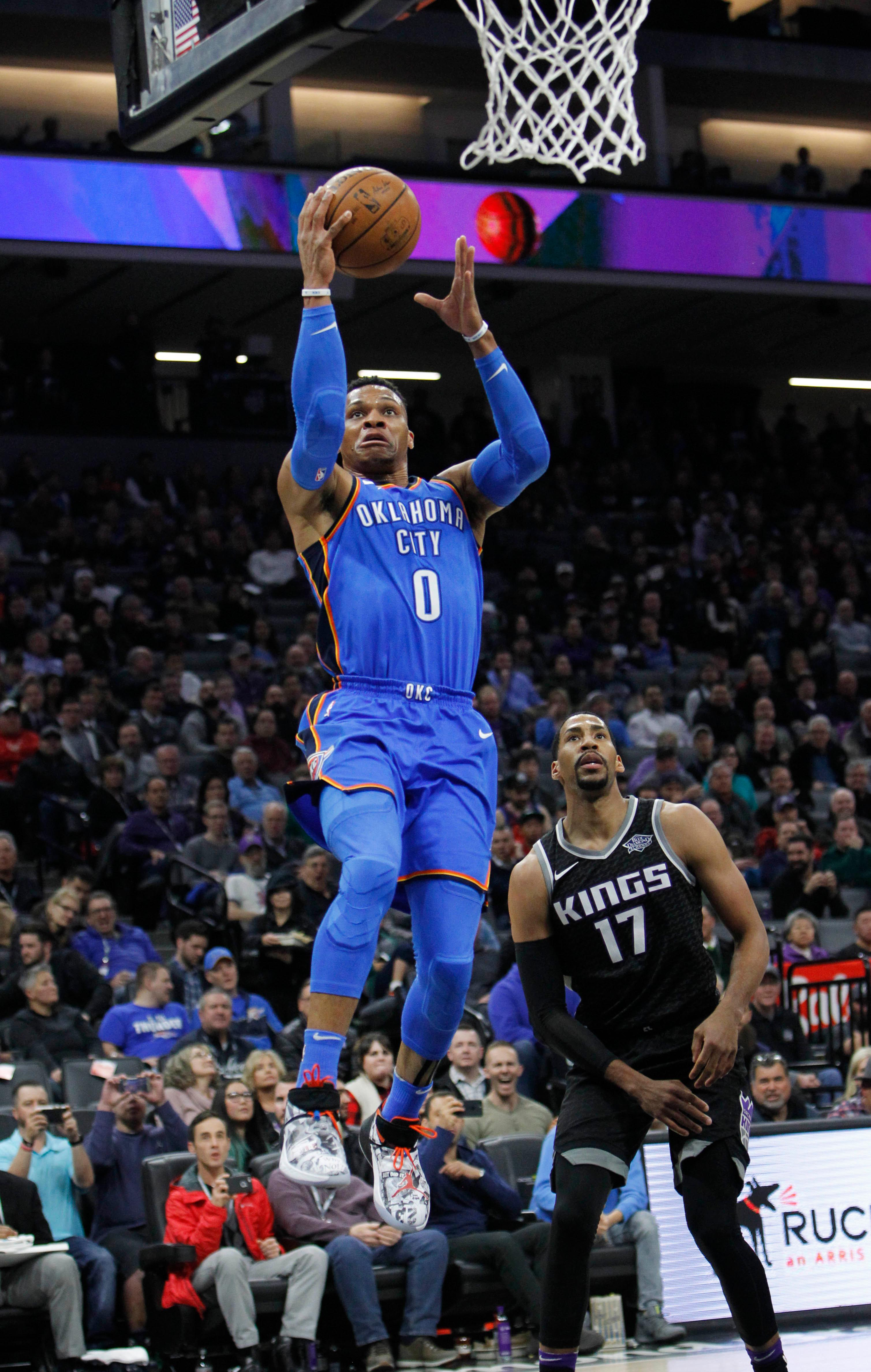 Oklahoma City Thunder guard Russell Westbrook (0) drives to the basket past Sacramento Kings guard Garrett Temple (17) during the first half of an NBA basketball game in Sacramento, Calif., Thursday, Feb. 22, 2018. (AP Photo/Steve Yeater)