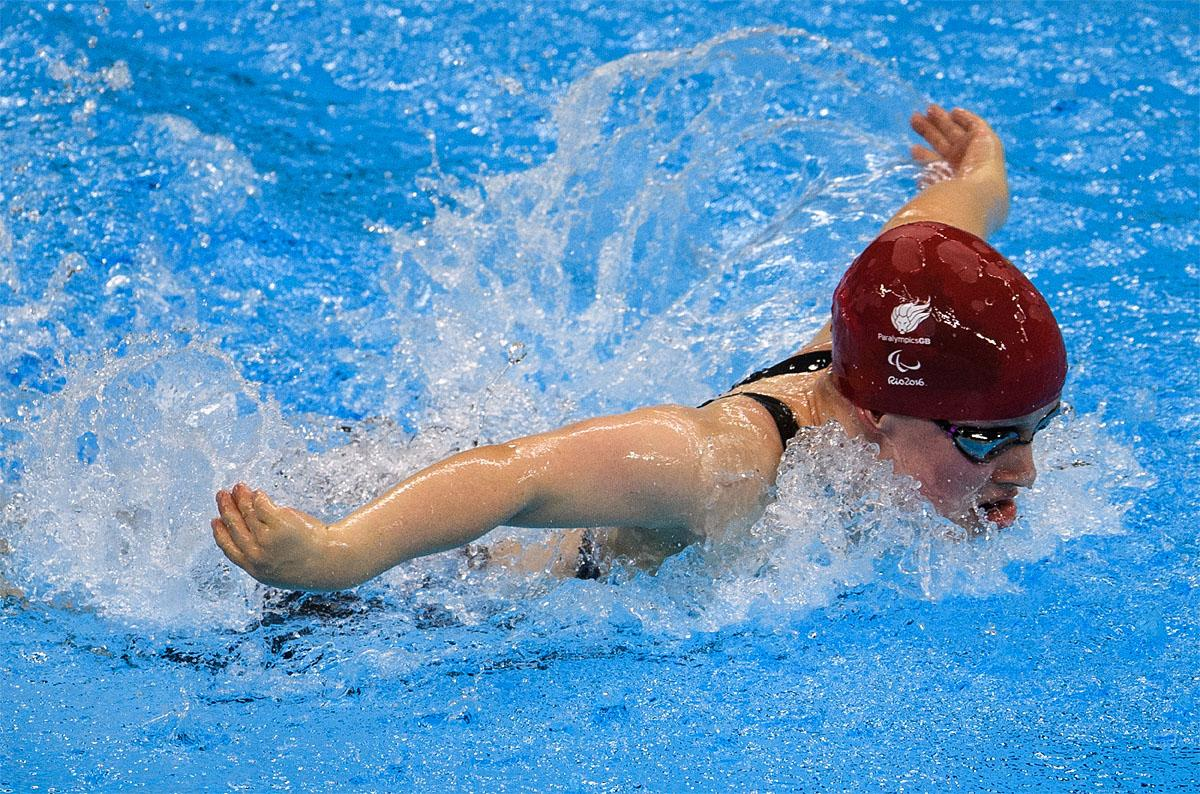 In this photo provided by the IOC, Britain's Ellie Robinson competes in women's 50-meter butterfly S6 heat 1 swimming event at the Olympic Aquatics Stadium during the Paralympic Games, in Rio de Janeiro, Brazil, Friday, Sept. 9, 2016. (Bob Martin/OIS,IOC via AP)