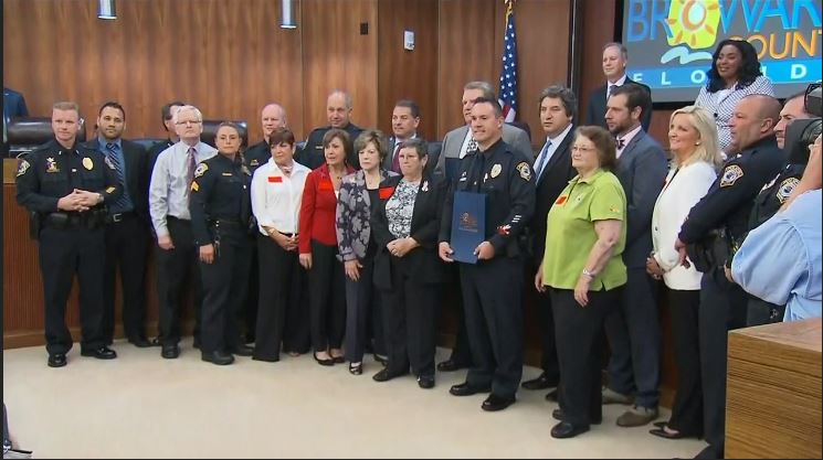 Commissioners read a proclamation declaring Tuesday, Feb. 27, 2018, as Officer Michael Leonard Appreciation Day in Broward County. (CNN Newsource)
