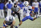 Memphis' Jake Elliott (46) kicks an extra point from the hold of Evan Michael (35) during the first half of an NCAA college football game against Cincinnati, Friday, Nov. 18, 2016, in Cincinnati. (AP Photo:John Minchillo) .jpeg