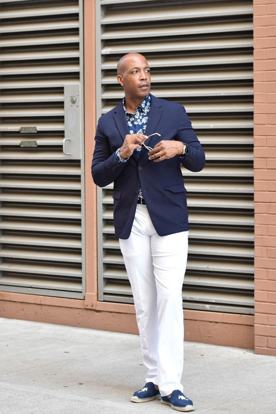 """You can still rock a great looking suit even when the weather seems oppressive,"" says Barnette Holston, also known as The DC Fashion Fool. ""Choose lighter fabrics such as cottons or linens. In addition, you can find some tailored clothing that is made with tech fabrics that are typically used for athleisure wear. The nice thing is that not only do they repel sweat, they also are wrinkle free, stain, dust and bacteria- repellent. They make great travel pieces as well."" (Image courtesy of Barnette Holston, @dcfashionfool,{ }https://www.dcfashionfool.com/)"