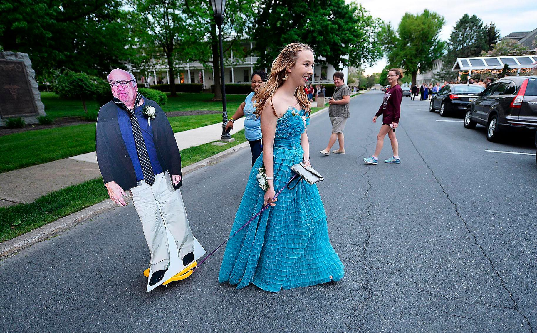 Allison Closs arrives for the Carlisle High School senior prom at Letort View Community Center at Carlisle Barracks in Carlise, Pa., on Friday, May 11, 2018.  Closs and her famous two-dimensional date joined other Carlisle High School seniors Friday for prom. Closs purchased the cutout of DeVito online along with a scooter she used to move the figure with.   (Michael Bupp /The Sentinel via AP)