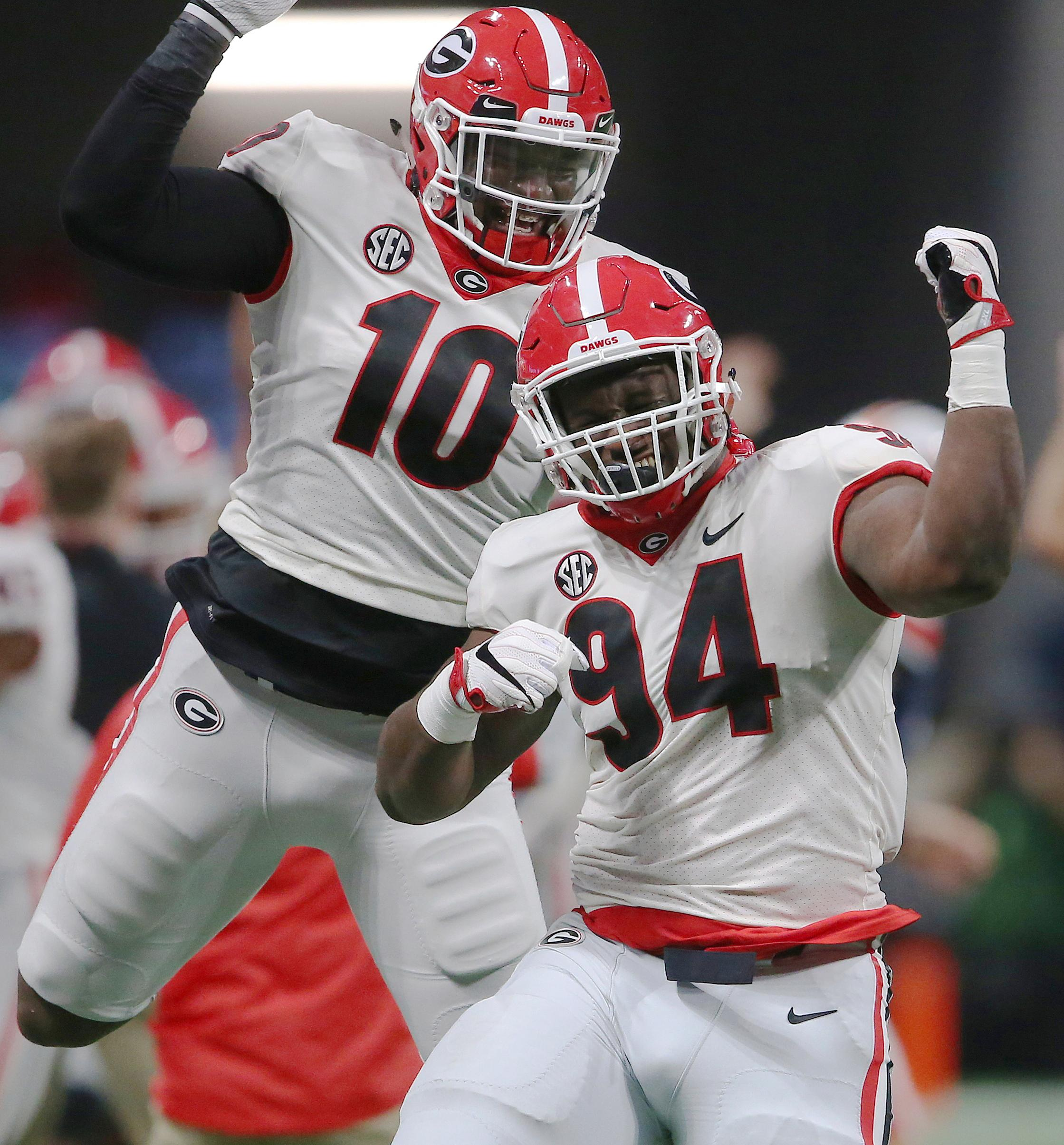 Georgia's Malik Herring (10) and Michael Barnett (94) celebrate a blocked field goal against Auburn during the second half of the Southeastern Conference championship NCAA college football game, Saturday, Dec. 2, 2017, in Atlanta. (AP Photo/John Bazemore)