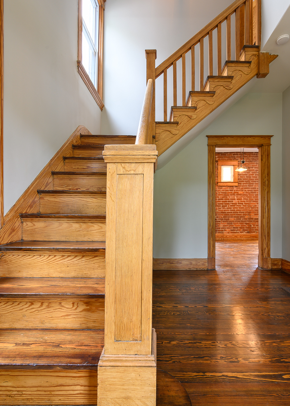 The first floor staircase features ornate woodwork you won't find in a newly built house. The renovation cleaned it up without replacing it. / Image: Phil Armstrong, Cincinnati Refined // Published: 9.29.19