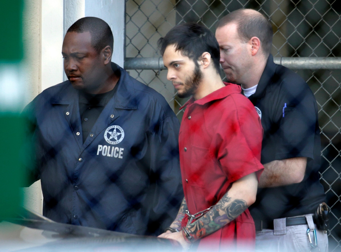 Esteban Santiago, center, leaves the Broward County jail for a hearing in federal court, Tuesday, Jan. 17, 2017, in Fort Lauderdale, Fla. Santiago is accused of a Jan. 6 shooting rampage at a Fort Lauderdale-Hollywood International Airport baggage claim area that left several people dead and others wounded. (AP Photo/Lynne Sladky)