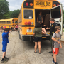 Mid-Prairie holds Iowa's first all-district school bus evacuation training