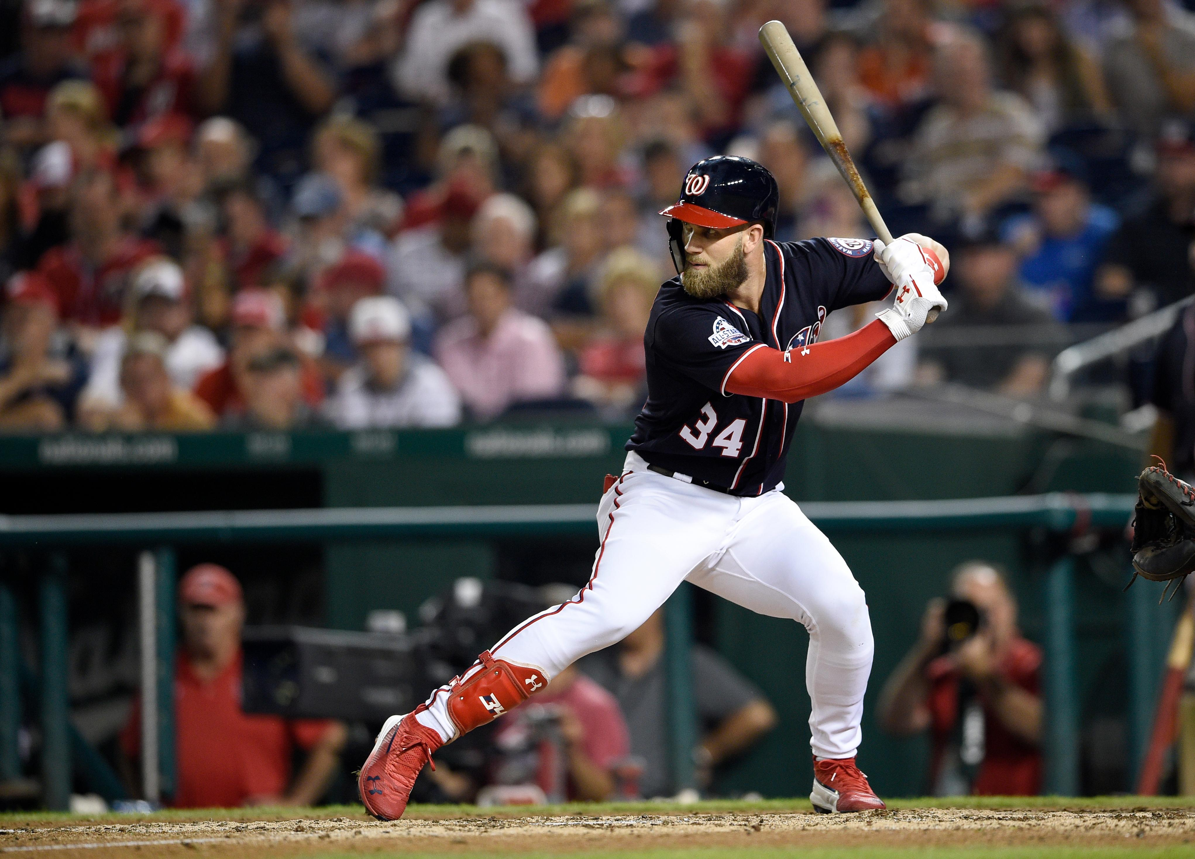 Washington Nationals' Bryce Harper bats during a baseball game against the New York Mets, Friday, Sept. 21, 2018, in Washington. (AP Photo/Nick Wass)