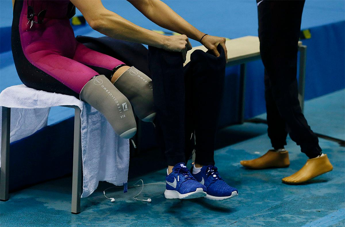 United States' Jessica Long puts on her prosthetic legs after competing in the women's 400-meter freestyle S8 final swimming event at the Paralympic Games in Rio de Janeiro, Brazil, Thursday Sept. 8, 2016. (AP Photo/Leo Correa)