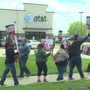 AT&T workers go on strike over weekend in hopes of change