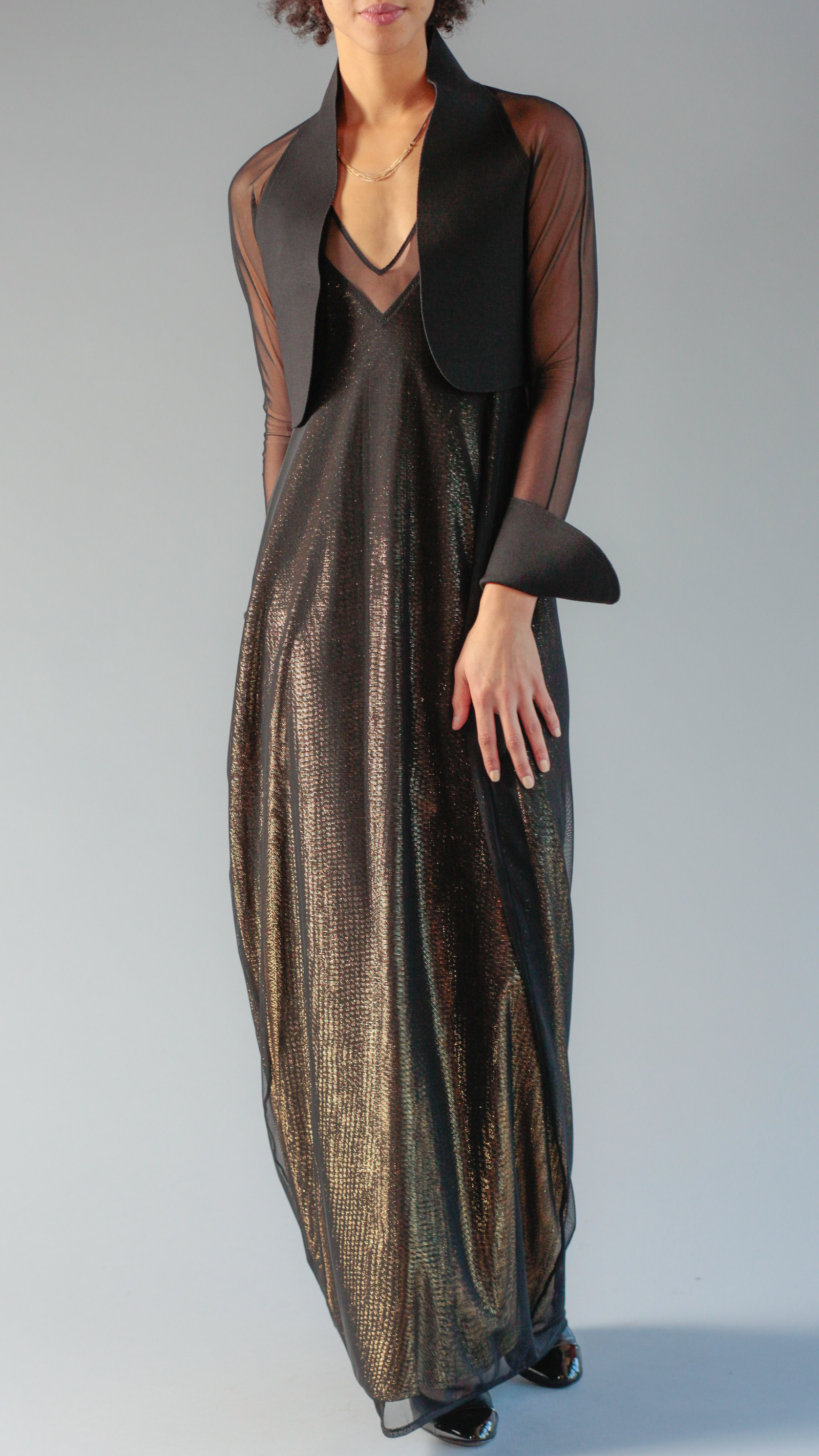 Another glittery statement piece, this floor-length black and gold glittered dress, is certainly a dress you wear to impress, and you have to be willing to invest if you want to go with this option. $1500 (Image: Dayna Smith/Courtesy Betsy Fisher)