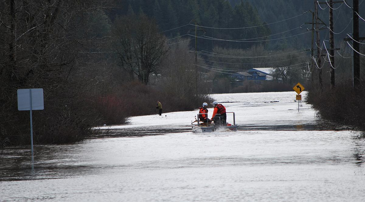 FILE - Forest Grove Fire rescues man stuck on submerged SUV on Fern Hill Road Feb. 9, 2017