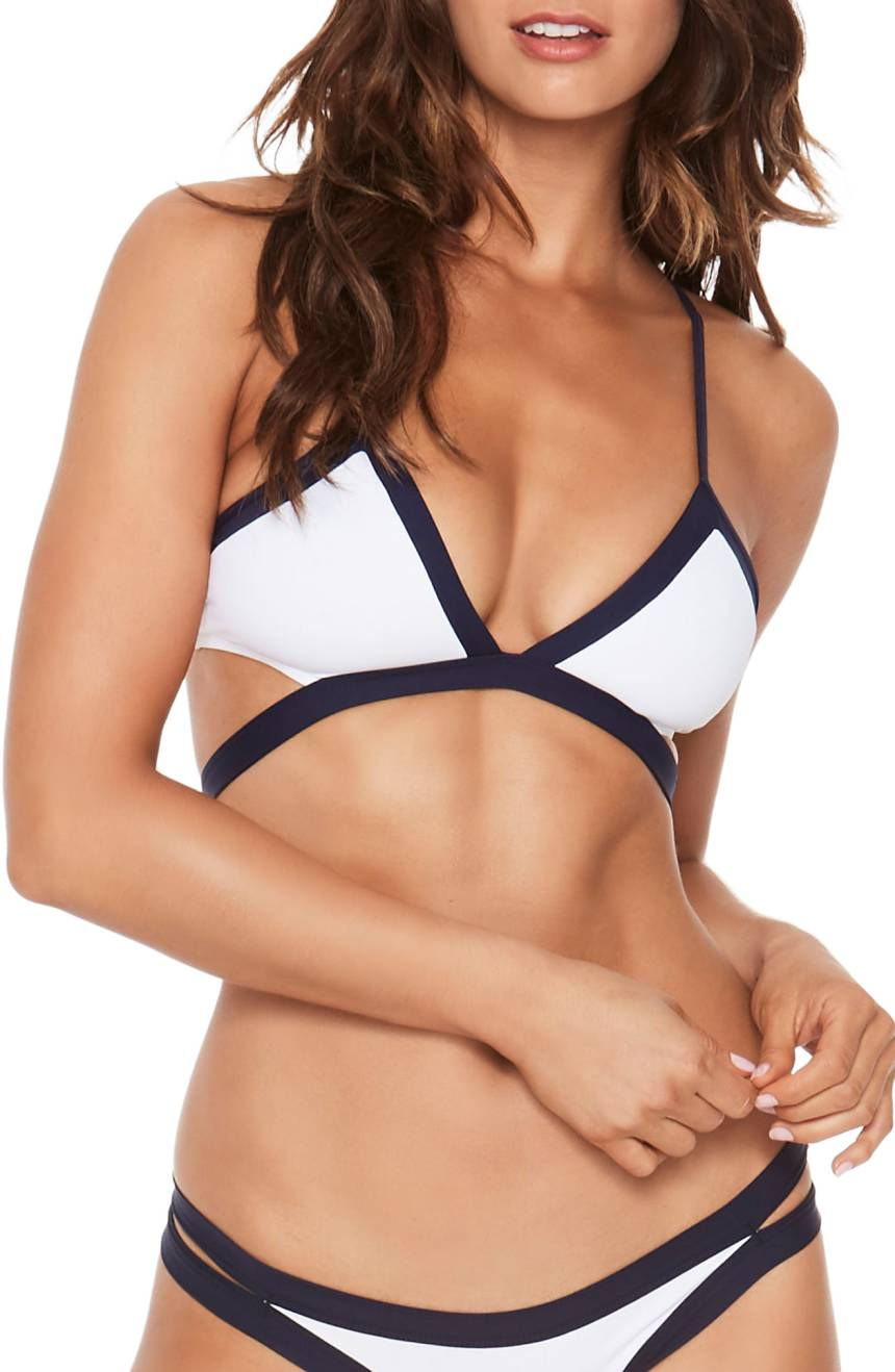 ATHLETIC: You're more straight up and down and have fewer curves, like Cameron Diaz, Jessica Biel, and Jennifer Aniston. What to look for: The name of the game is playing up your curves with styles that flaunt your frame. Suits with less coverage help to create the illusion of a shapelier figure. Domino Platinum Bikini Top, $88 (Image: Nordstrom)