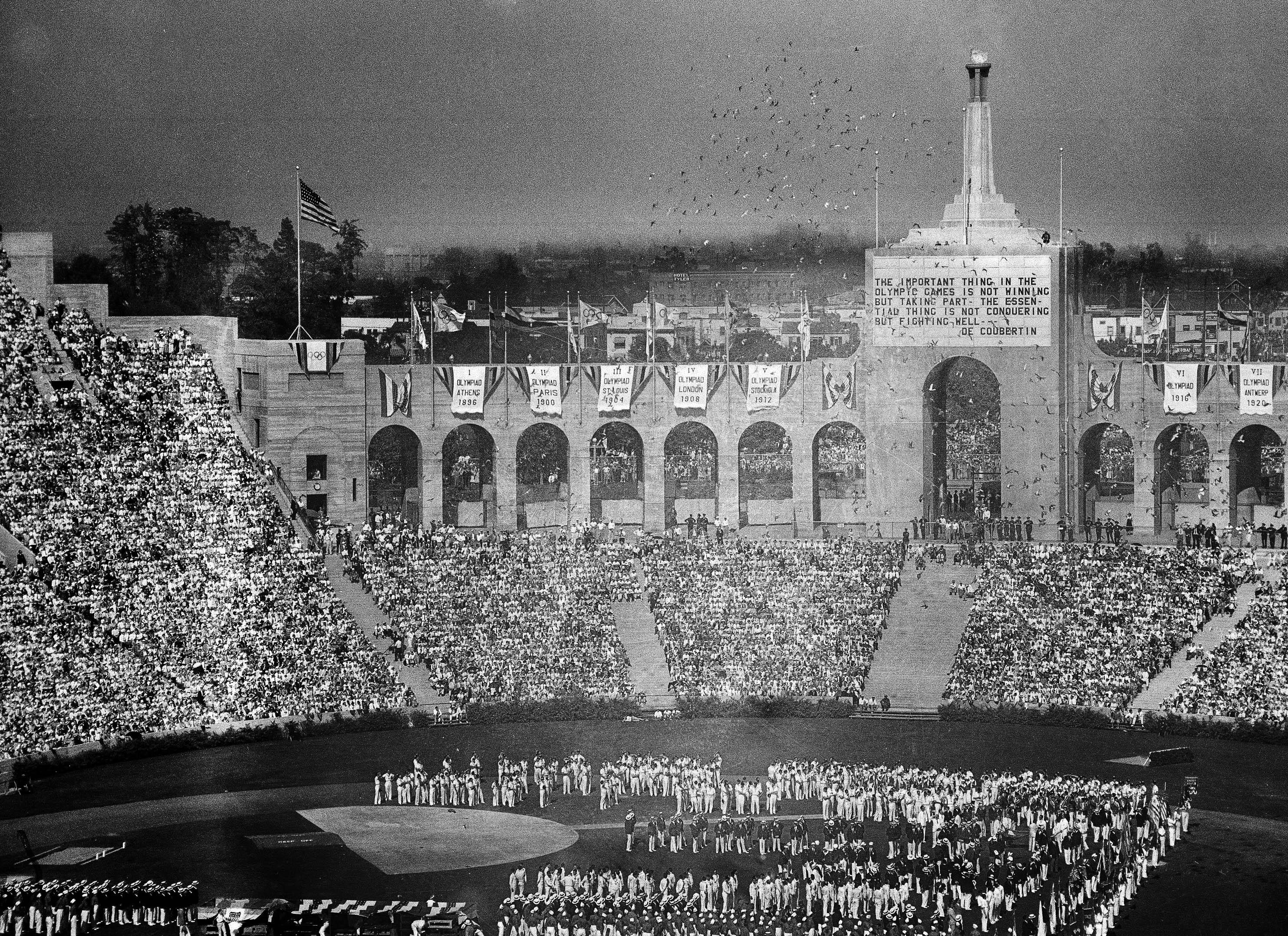 FILE -  In this July 30, 1932, file photo, doves are released during opening ceremonies of the Tenth Olympiad at the Coliseum in Los Angeles. (AP Photo)
