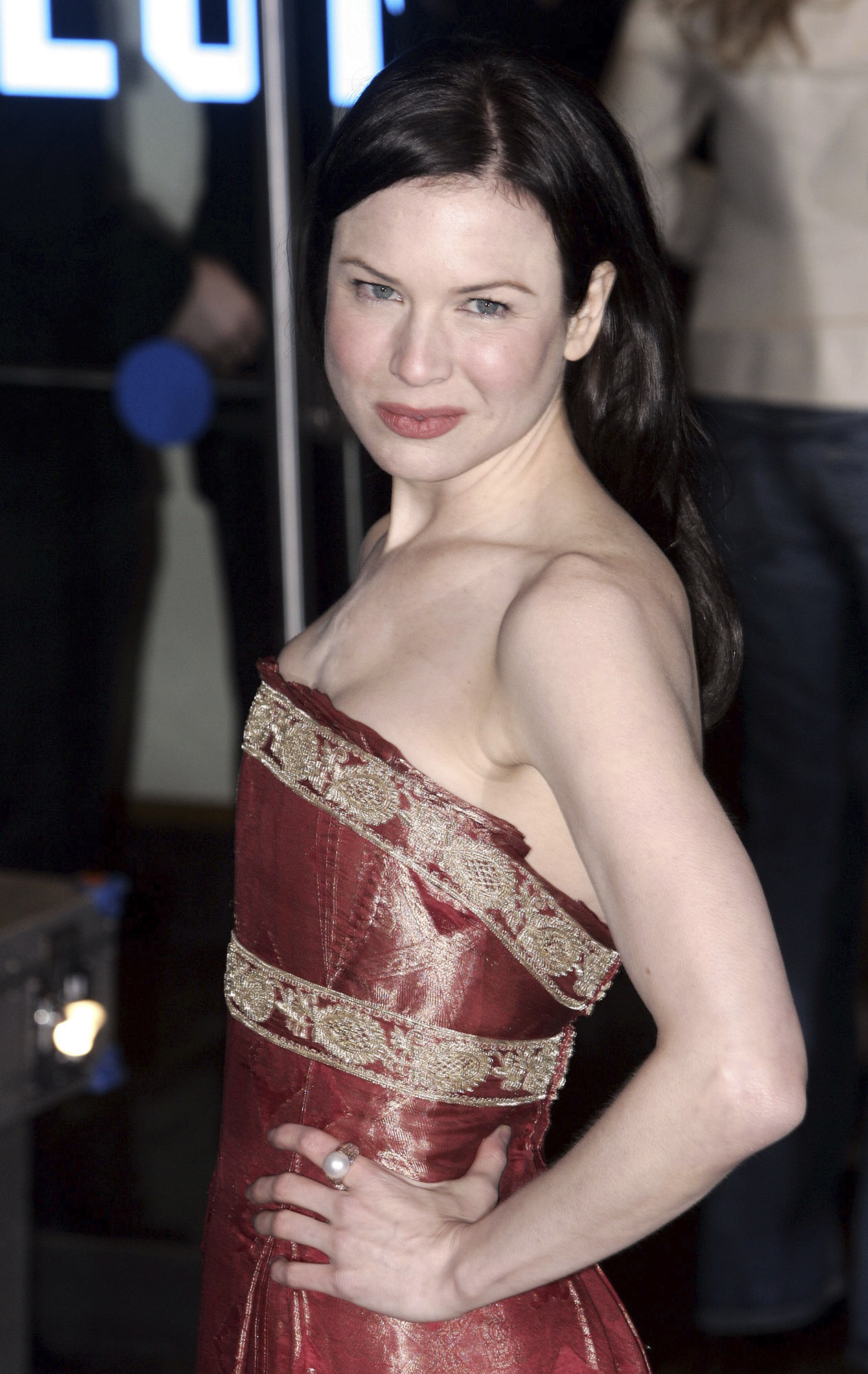 "FILE - In this Nov. 9, 2004 file photo, actress Rene Zellweger wears a Marchesa dress at the premiere of her film ""Bridget Jones: The Edge of Reason."" Marchesa co-founder Georgina Chapman took what some believed was her only brand-saving leap Tuesday, Oct. 10, 2017, as sex abuse allegations against her husband Harvey Weinstein mounted. Breaking her six-day silence, she told People she was leaving the film mogul she married in 2007. The divorce revelation came as some on social media called for a Marchesa boycott. (AP Photo/Adam Butler, File)"