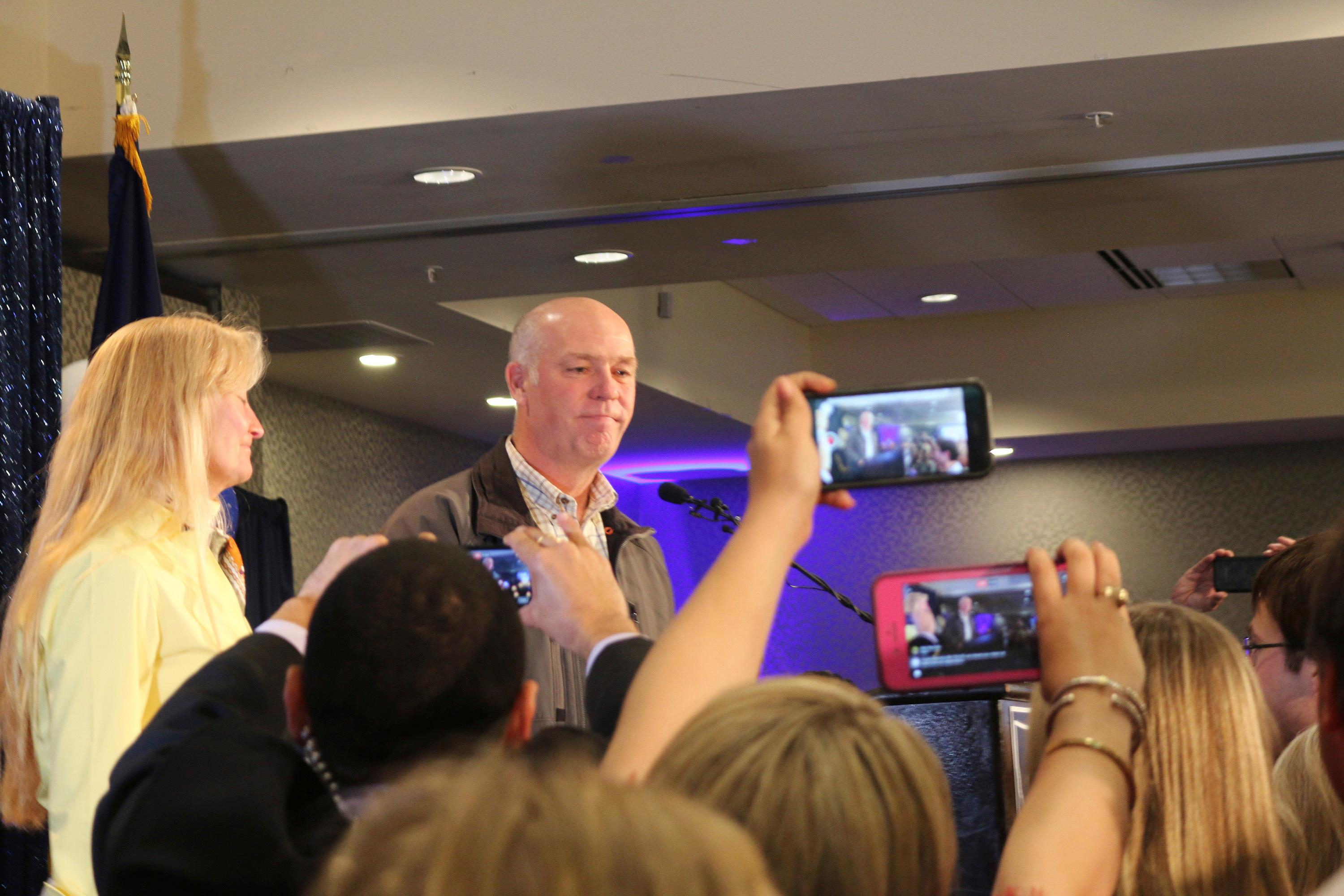 Republican Greg Gianforte greets supporters at a hotel ballroom after winning Montana's sole congressional seat, Thursday, May 25, 2017, in Bozeman, Mont. In his speech, Gianforte apologized for a altercation at his campaign headquarters with a reporter on the eve of the special election. The altercation led to a misdemeanor assault citation. (AP Photo/Bobby Caina Calvan)