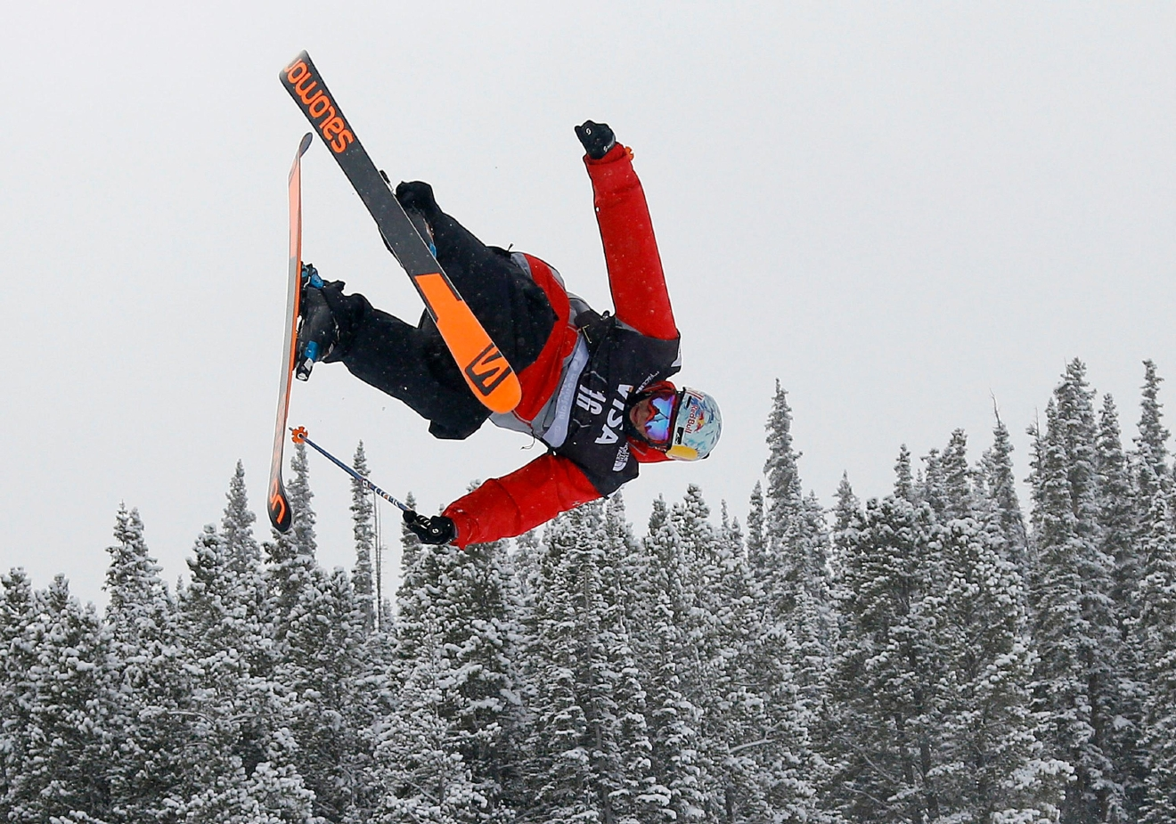 FILE - In this Dec. 21, 2013, file photo, Bobby Brown flies off a jump during the World Cup U.S. Grand Prix slope style freestyle skiing finals in Frisco, Colo. Brown, who has come back from breaking his back, pelvis and both ankles from wipeouts while in competitions, will take part in the Winter X Games this weekend in Aspen, Colo. (AP Photo/Julie Jacobson, file)