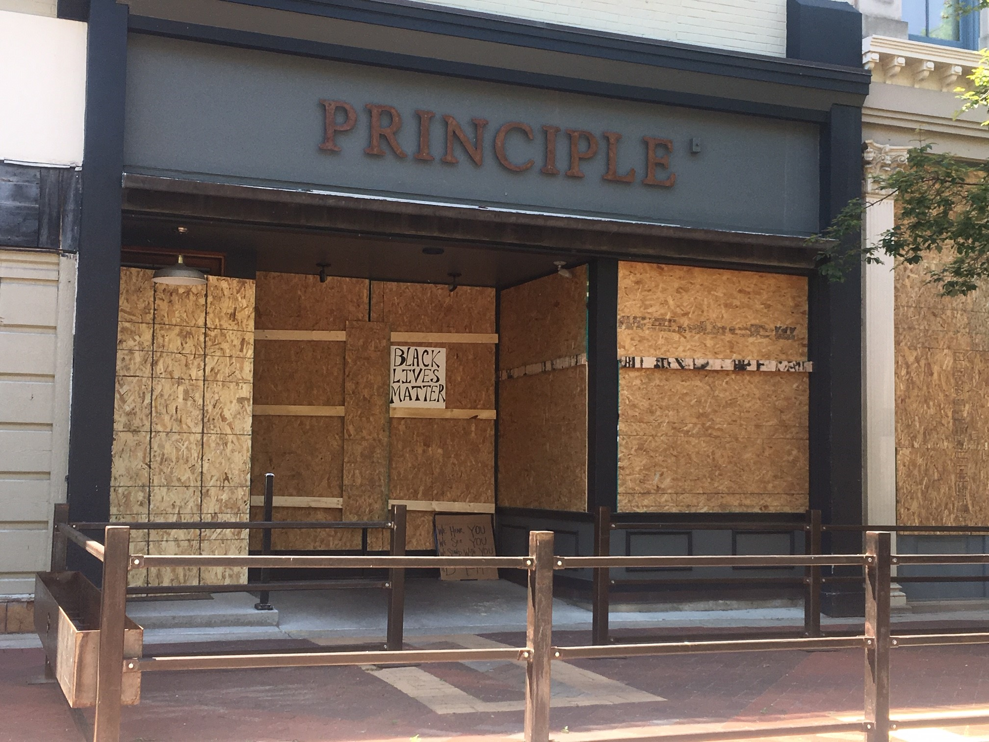 Principle Food and Drink sits boarded up Tuesday, June 2, 2020, after announcing on its website that it is closing for the day. The restaurant says it will reopen Wednesday. (WWMT/Mike Krafcik)