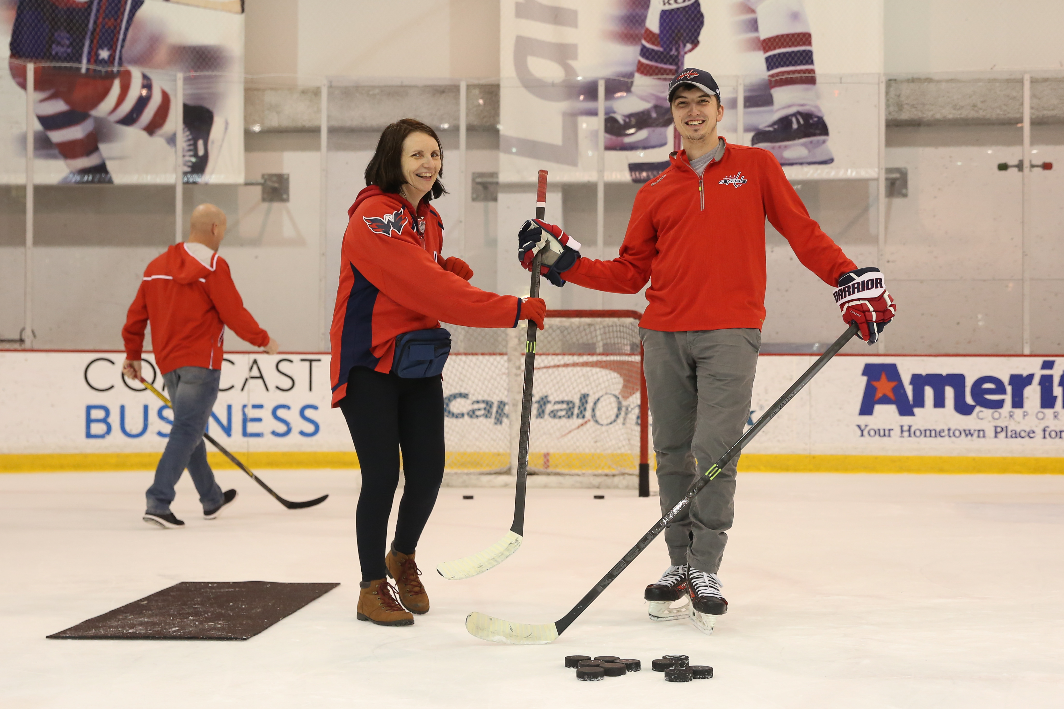 Female fans of the Caps hit the ice for the team's annual 'Hockey and Heels' night at Kettler Capitals Iceplex on January 30. The evening gives fans a chance to play a little broomball, hit pucks and snap selfies with some of their favorite players. Hockey and Heels is run by the Scarlet Caps, the team's women-only fan group. (Amanda Andrade-Rhoades/DC Refined)