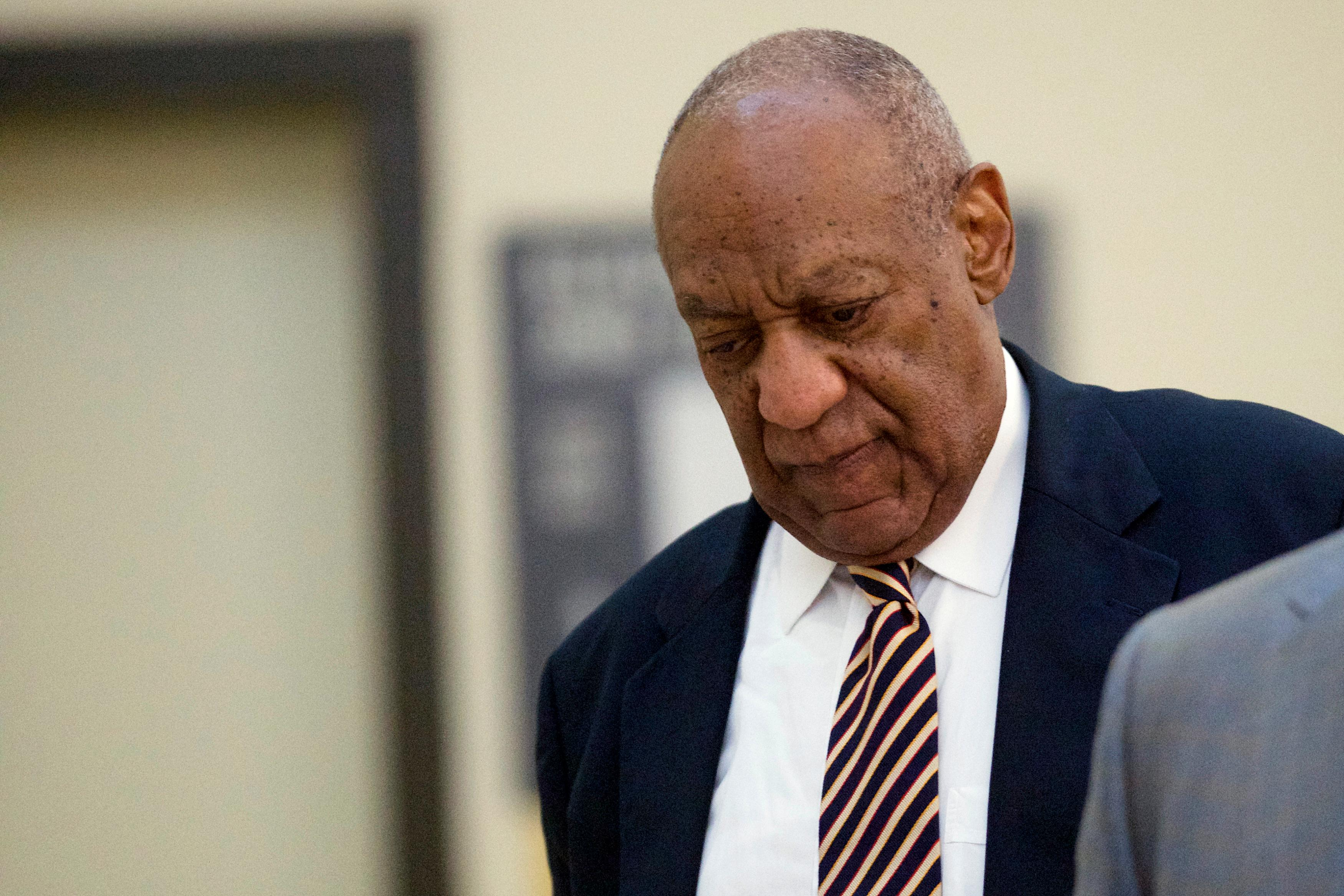 Bill Cosby walks through the Montgomery County Courthouse during jury deliberations in his sexual assault trial in Norristown, Pa., Wednesday, June 14, 2017. (Mark Makela/Pool Photo via AP)