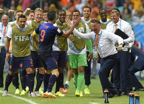 Netherlands' Robin van Persie celebrates with Netherlands' head coach Louis van Gaal after scoring a goal during the group B World Cup soccer match between Spain and the Netherlands at the Arena Ponte Nova in Salvador, Brazil, Friday, June 13, 2014.