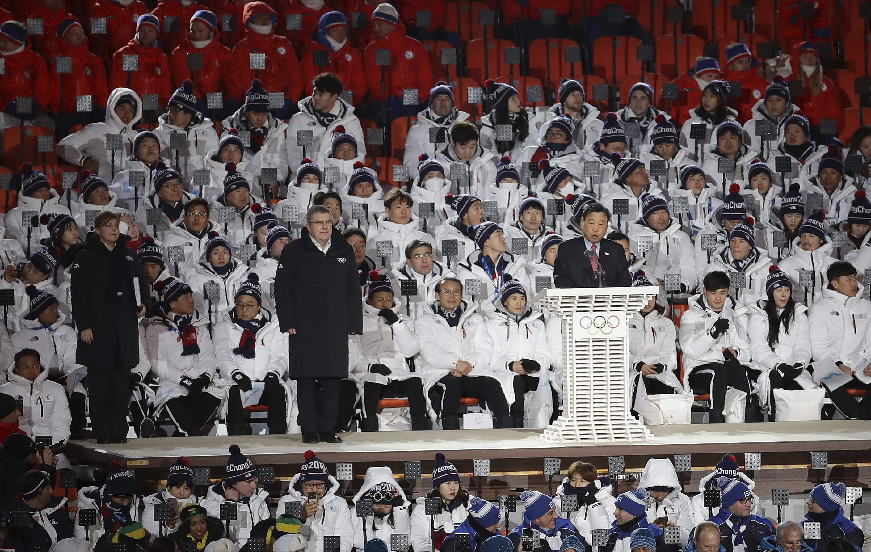 Lee Hee-beom, president & CEO of the Pyeongchang Organizing Committee speaks as International Olympic Committee President Thomas Bach stands at left during the opening ceremony of the 2018 Winter Olympics in Pyeongchang, South Korea, Friday, Feb. 9, 2018. (AP Photo/Michael Sohn)