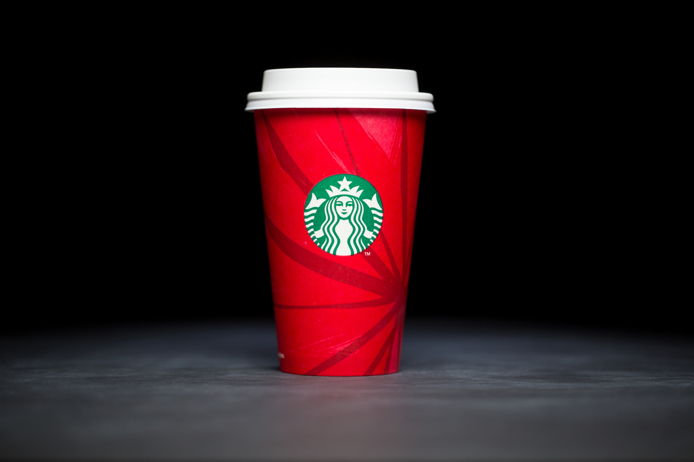 2014: For 20 years, Starbucks have released a range of holiday cup designs, most of them based around their world famous red cup. It's not easy to find the very first Starbucks holiday cups, which made their debut in stores in 1997. Few were saved, and electronic design files were lost in an earthquake in 2001. Even an Internet search is unyielding, with the cups having made their arrival long before the first selfie. But, we have them here! Click on for a photos of all 20 holidays cup designs. (Image: Joshua Trujillo/Cover Images)
