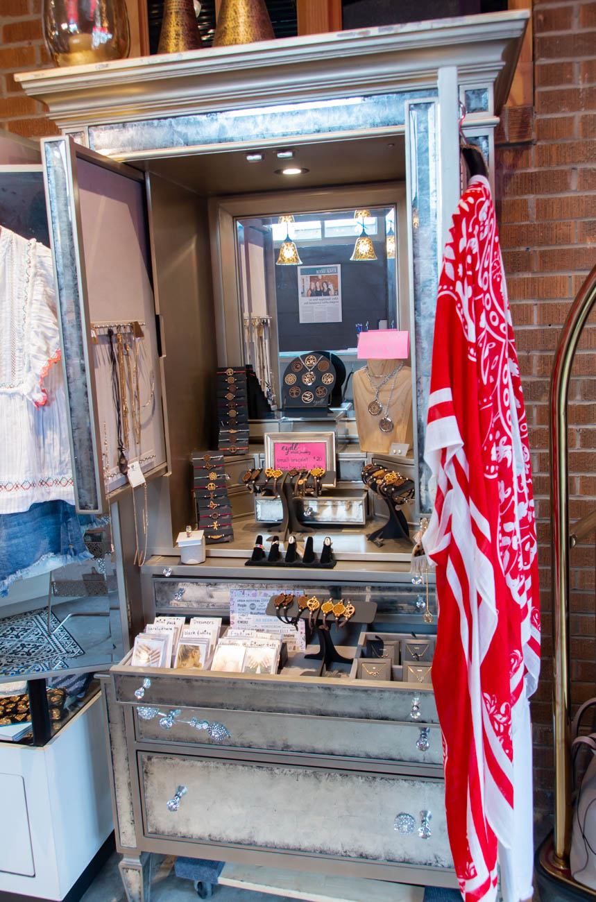 Opening Alley Boutique's current spot was a community effort. What was originally a storage unit, the recreated space now includes furniture from the former Pizazz Studio across the street; interior painting and decorating by Janel, Ann Marie, and their spouses; and a beautiful, reclaimed wood wall built by Captain Bruce Hawk of the Loveland Symmes Fire Department. Eads Fence Co. repaired their spherical overhead light fixture, and Bob Long of Trebor Electrical Contractors did all the electric wiring. They had previously rented a space from Long when they needed a place to park their trailer. / Image: Elizabeth A. Lowry // Published: 8.27.19