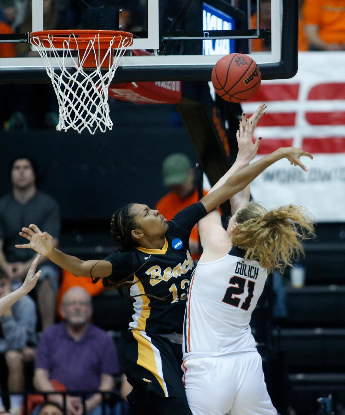 Long Beach State's Jewelyn Sawyer (13) fouls Oregon State's Marie Gulich (21) as she scores during the first half of a first-round game in the women's NCAA college basketball tournament Friday, March 17, 2017, in Corvallis, Ore. (AP Photo/Timothy J. Gonzalez)