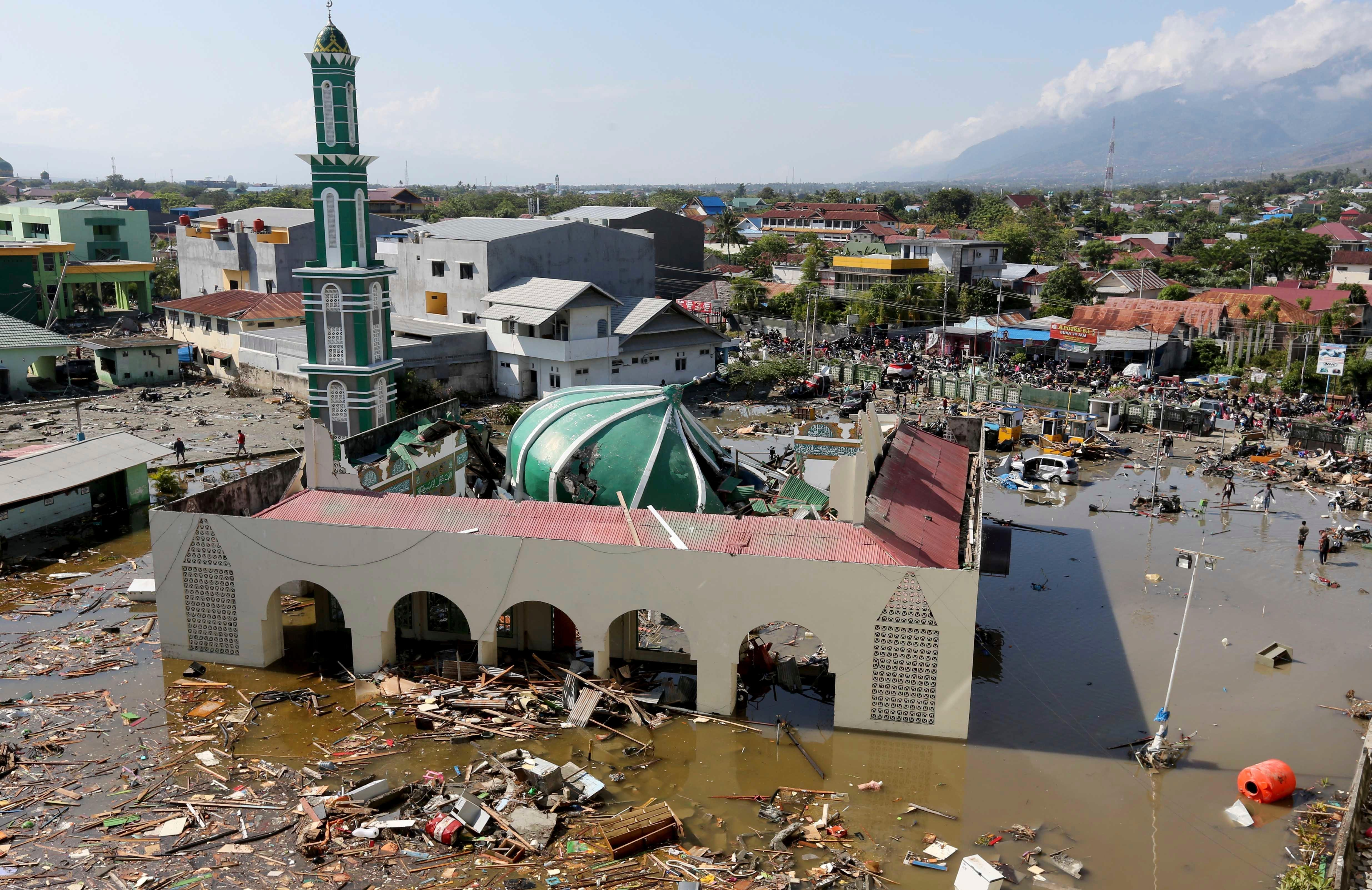 Tsunami and earthquake kills an estimated 850 in Indonesia. Water ravaged this mosque damaged in a massive earthquake and a tsunami in Palu, Central Sulawesi, Indonesia. (AP Photo/Tatan Syuflana, File)